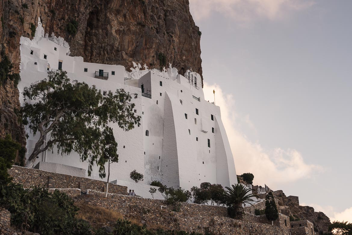 This is a close up of the whitewashed monastery, built on the steep cliff.