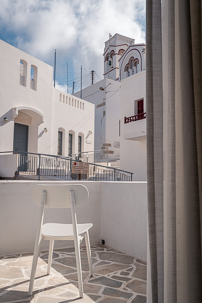 This photo shows the view from our room at Vigla Hotel Amorgos. The church of Agioi Anargyroi is visible as well as other whitewashed buildings.