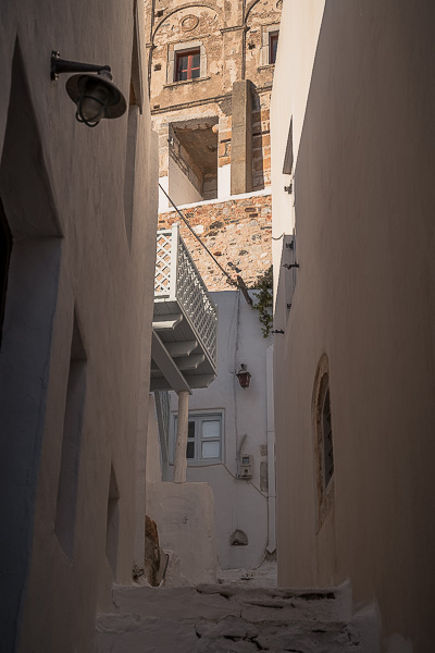 This photo shows an alley in Chora with view of the Castle.