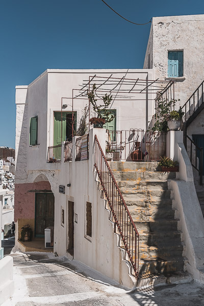 This image shows an alley in Chora lined with whitewashed buildings.