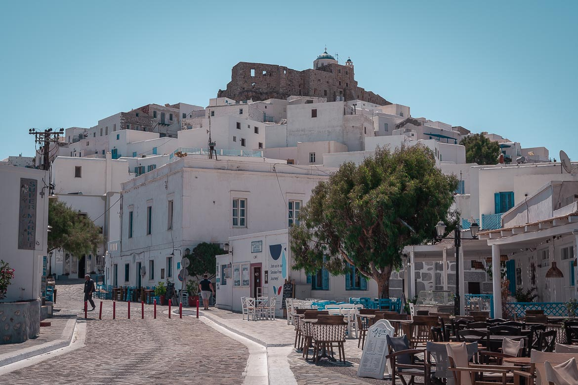 This is a panoramic shot of Chora with the Castle above the whitewashed buildings.