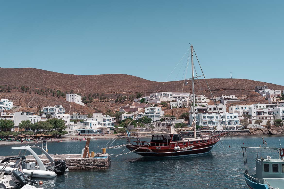 This image shows One of the boats that offers tours to the islets from Pera Gialos. It is a traditional wooden boat.