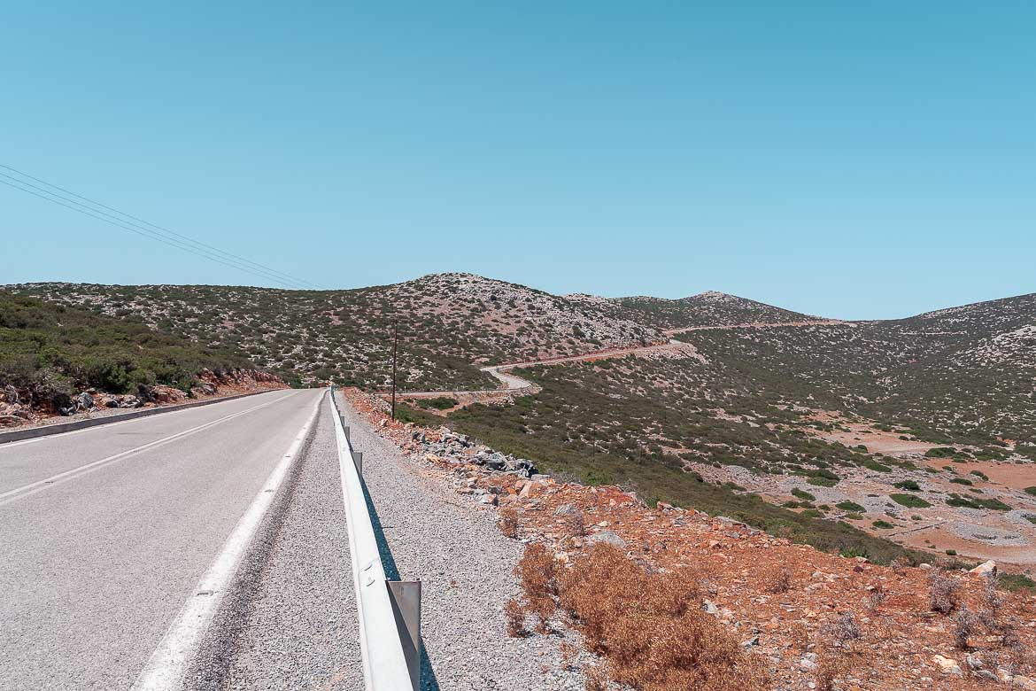 This image shows an open road in Astypalaia. The road winds its way through the mountain.