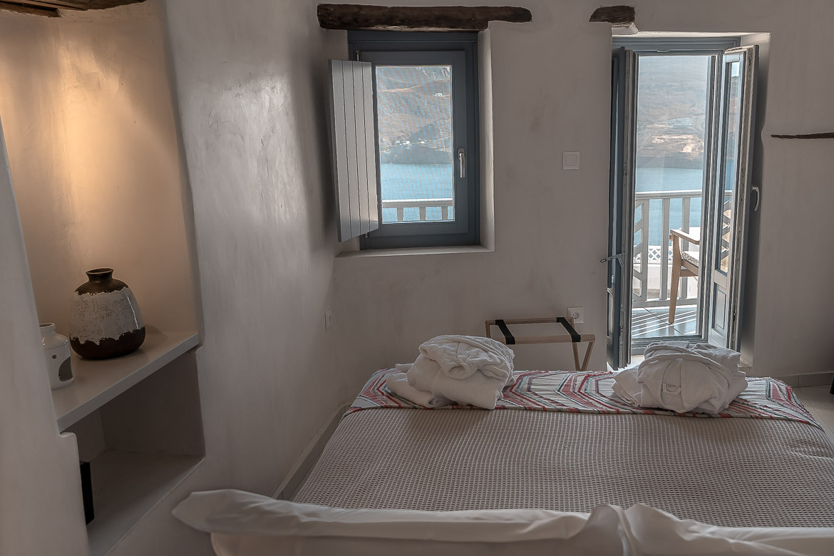 This image shows the view to the sea from the bedroom at Esperia Luxury Suites.