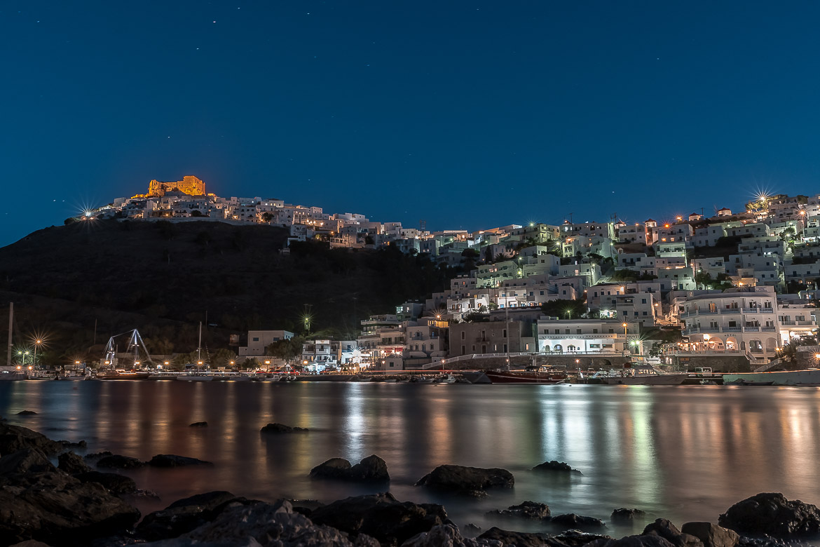 This is a night view of Chora and the castle. If you're wondering what to do in Astypalaia Greece, having dinner at Pera Gialos should definitely top your list!