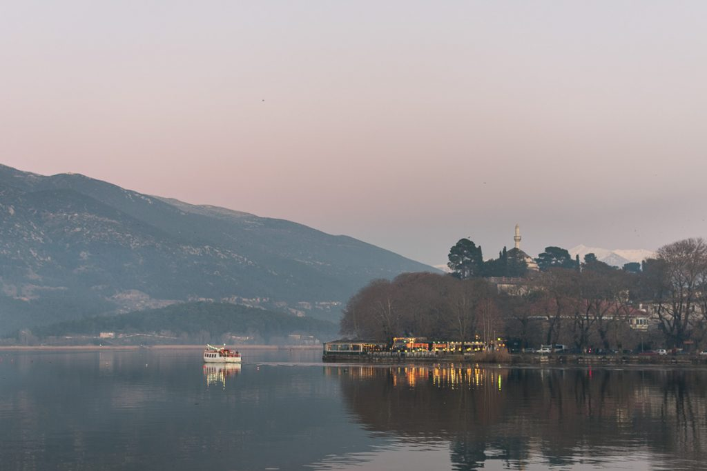 This is a panoramic shot of Ioannina Lake in the afternoon of a cold winter day. The ferry going to the island and the lights from cafes on the shore create perfect reflections on the tranquil waters. This photo shows the utter beauty of Ioannina city. This is why we set it as the featured image for the article: What to do in Ioannina Greece in winter.
