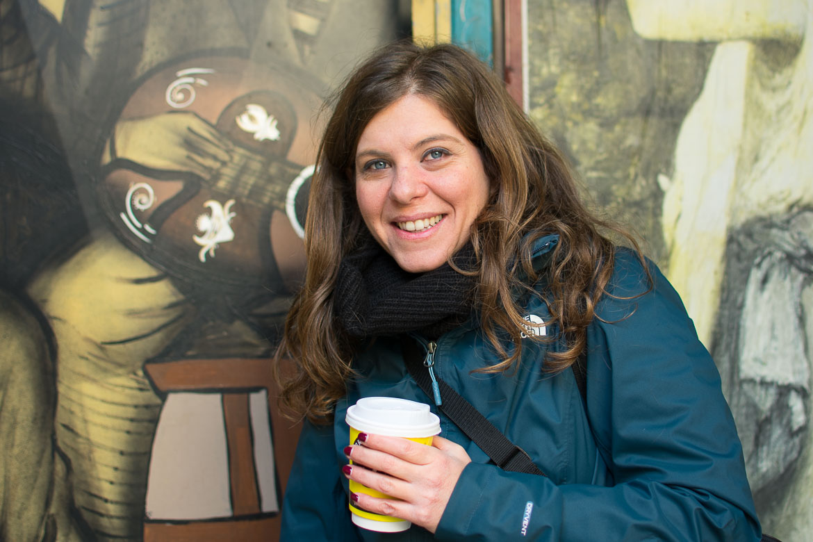 This image shows Katerina smiling with a cup of tea in her hand.