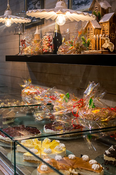 This photo was taken inside Motley Coffesweet. It shows the huge variety of cakes and other treats on display.