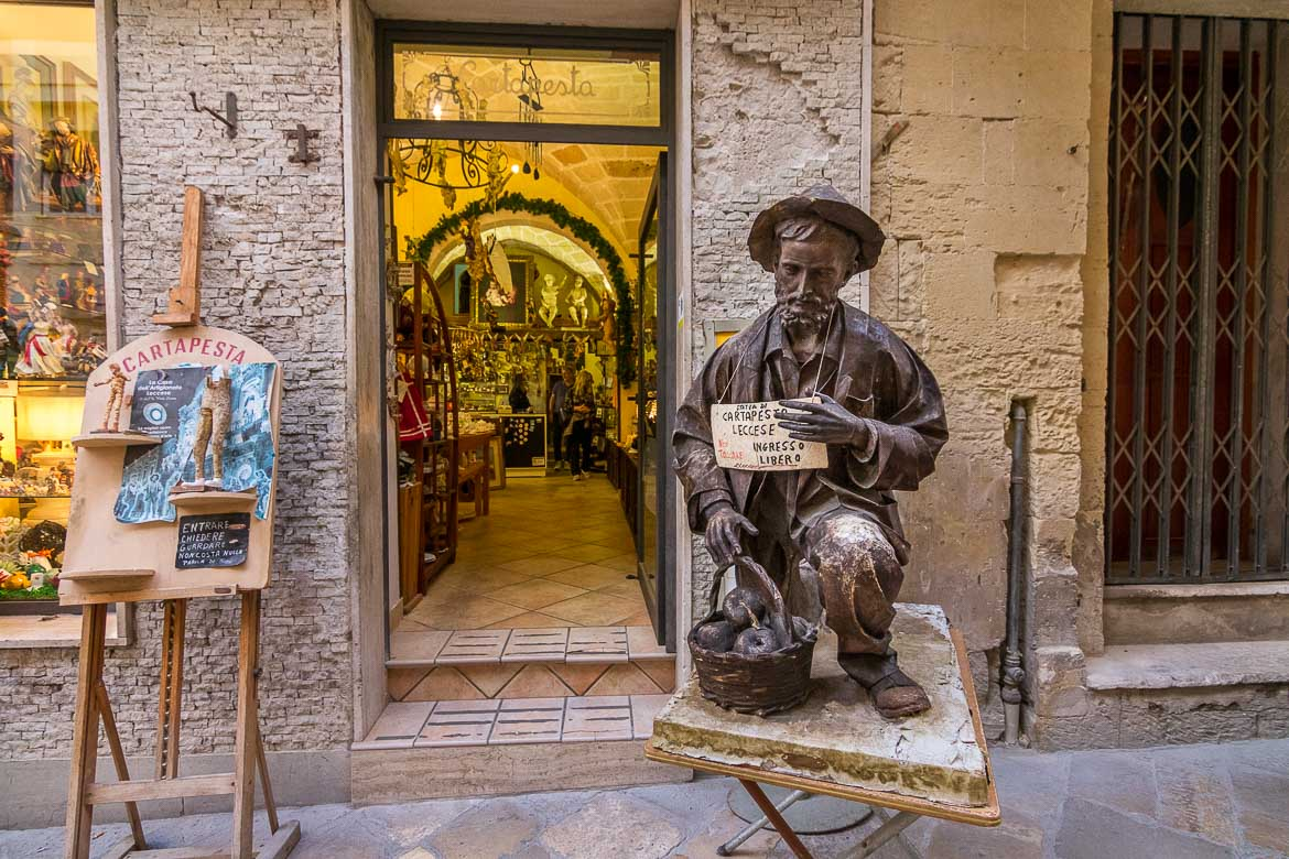 This photo shows a man made of papier mache outside a workshop in the old town, Lecce Italy.