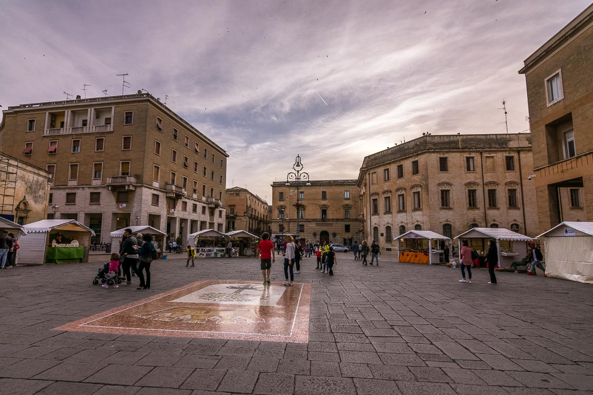 This photo shows Piazza Sant'Oronzo filled with people during the evening passeggiata.