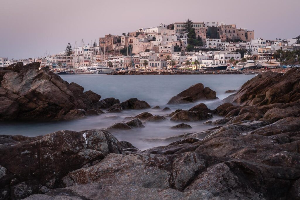 This image shows the view of Chora and the Castle and it's the feature image of our article: What To Do in Naxos – 35 Things To Do & Guide