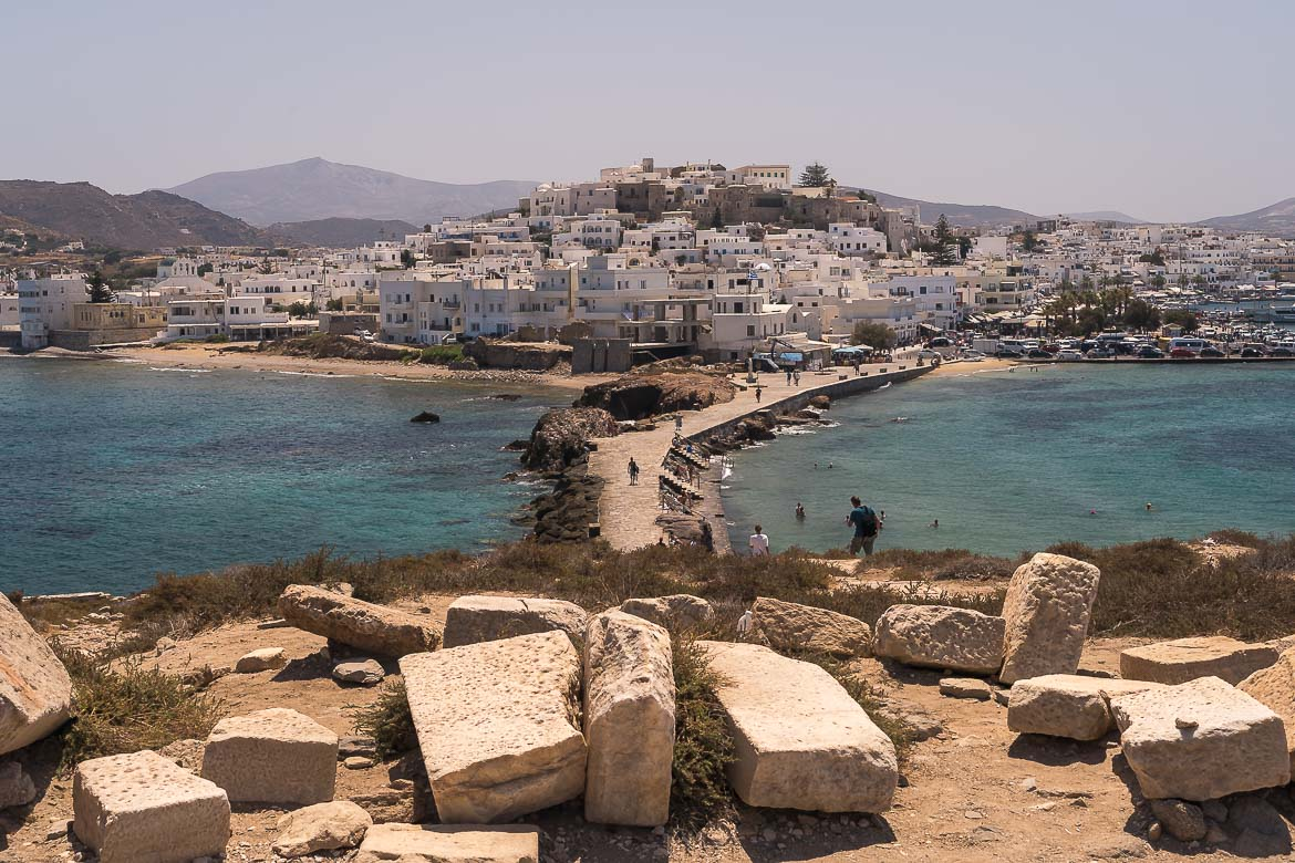 This image shows Chora Naxos and the castle. The photo is taken from Portara, the ultimate symbol of Naxos Greece.