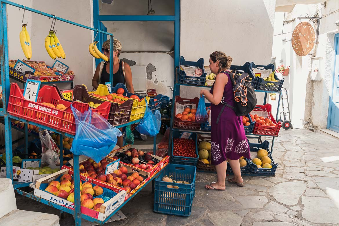 This image shows Maria shopping fruit and vegetables from a grochery in the old market.