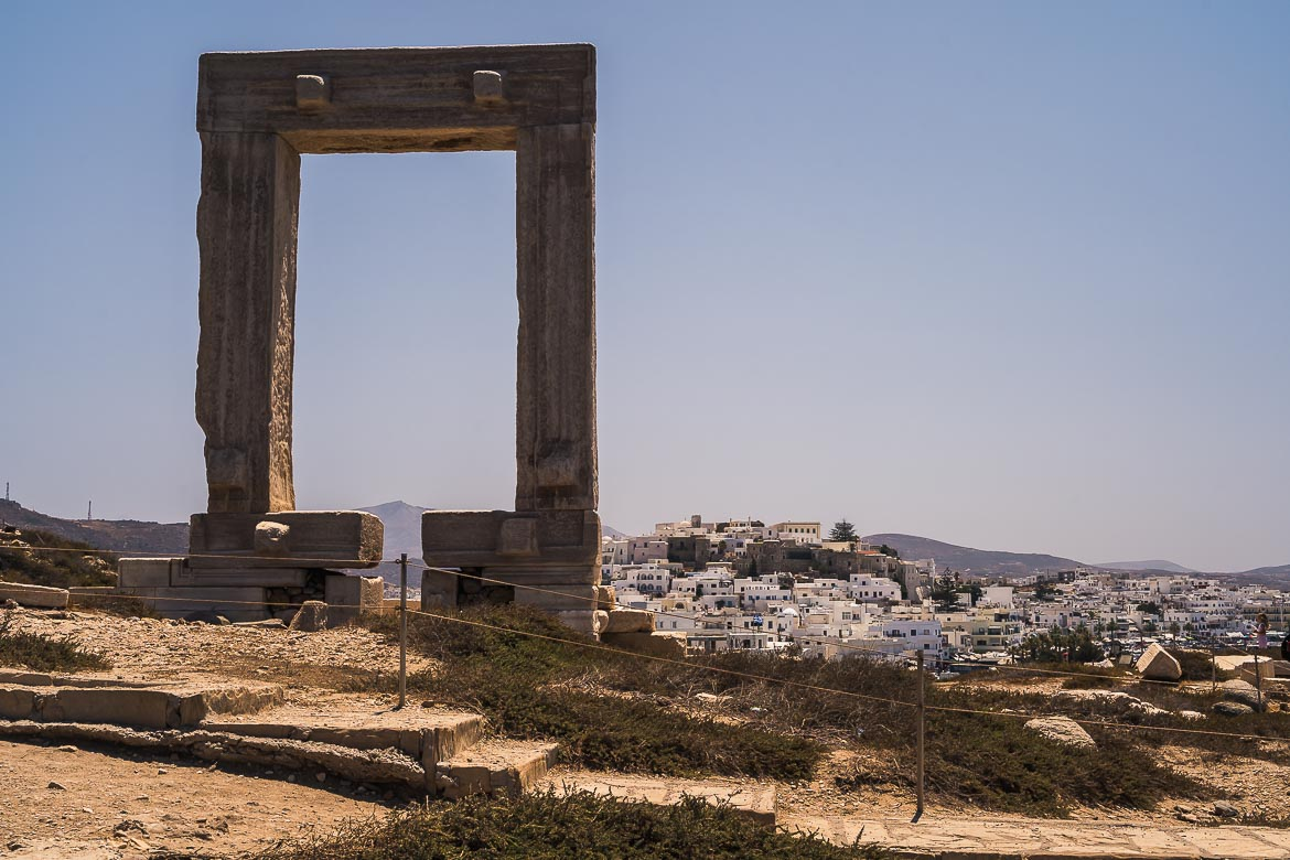 This image is taken from Portara in the morning. Portara is in the foreground and the castle of Naxos is in the background.