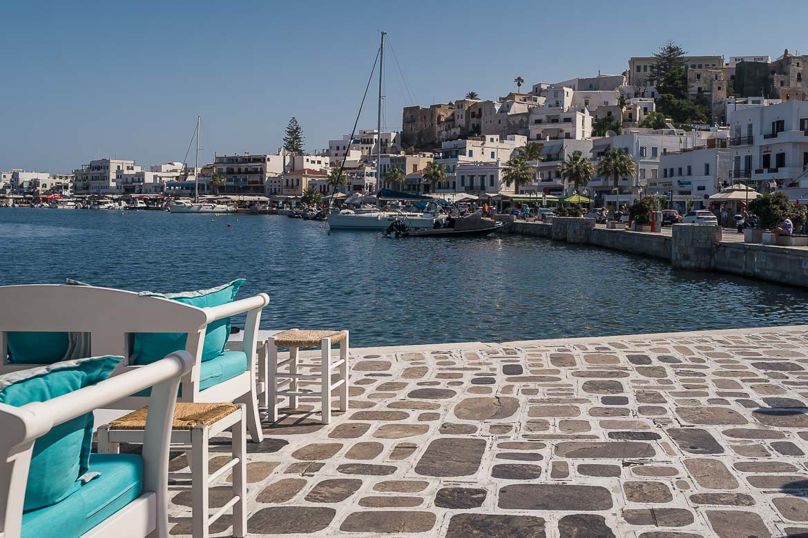 This image shows the promenade in Chora. If you're wondering what to do in Naxos Chora in the evening, people-watching at the promenade will do it.