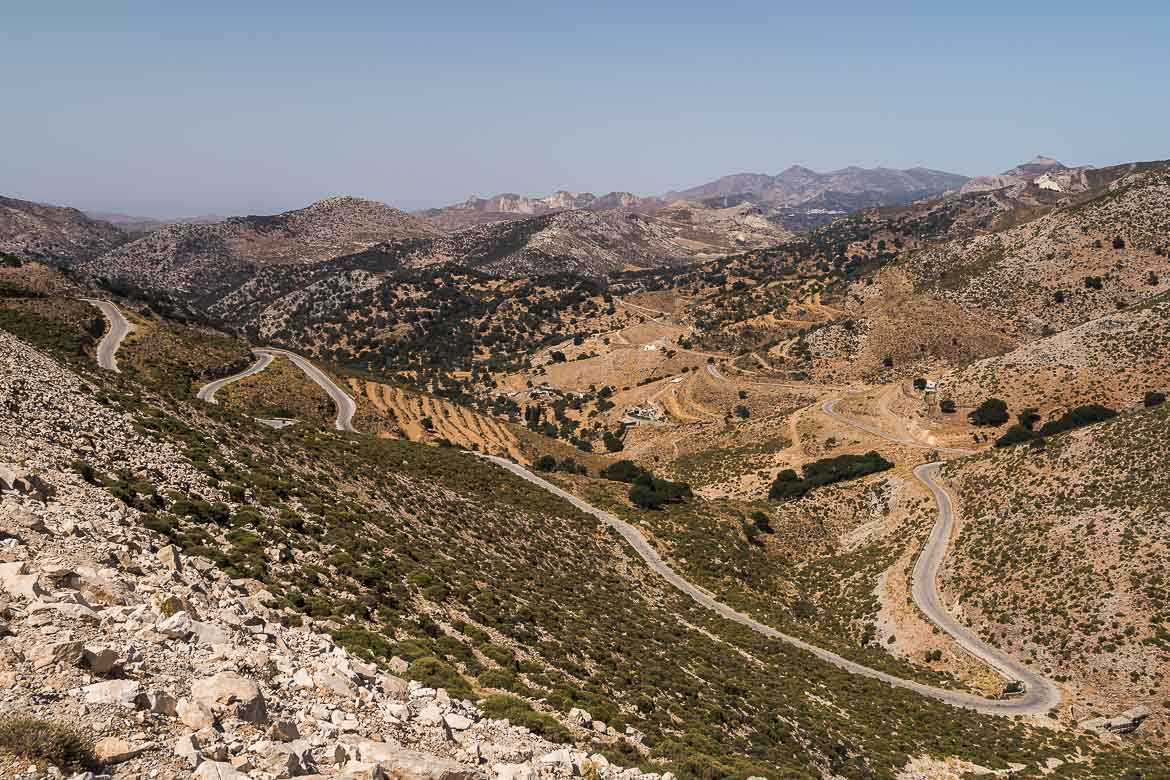 This image shows a panoramic view of the mountains and the scenic road with hairpin turns from our roadtrip to Kalandos beach.