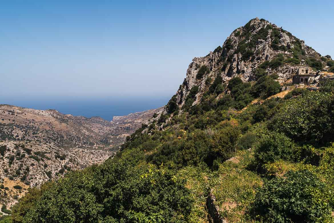 This image shows a panoramic view of Naxos mountains the way we saw it during our roadtrip from Apollonas to Koronos. Driving is one of the best things to do in Naxos.