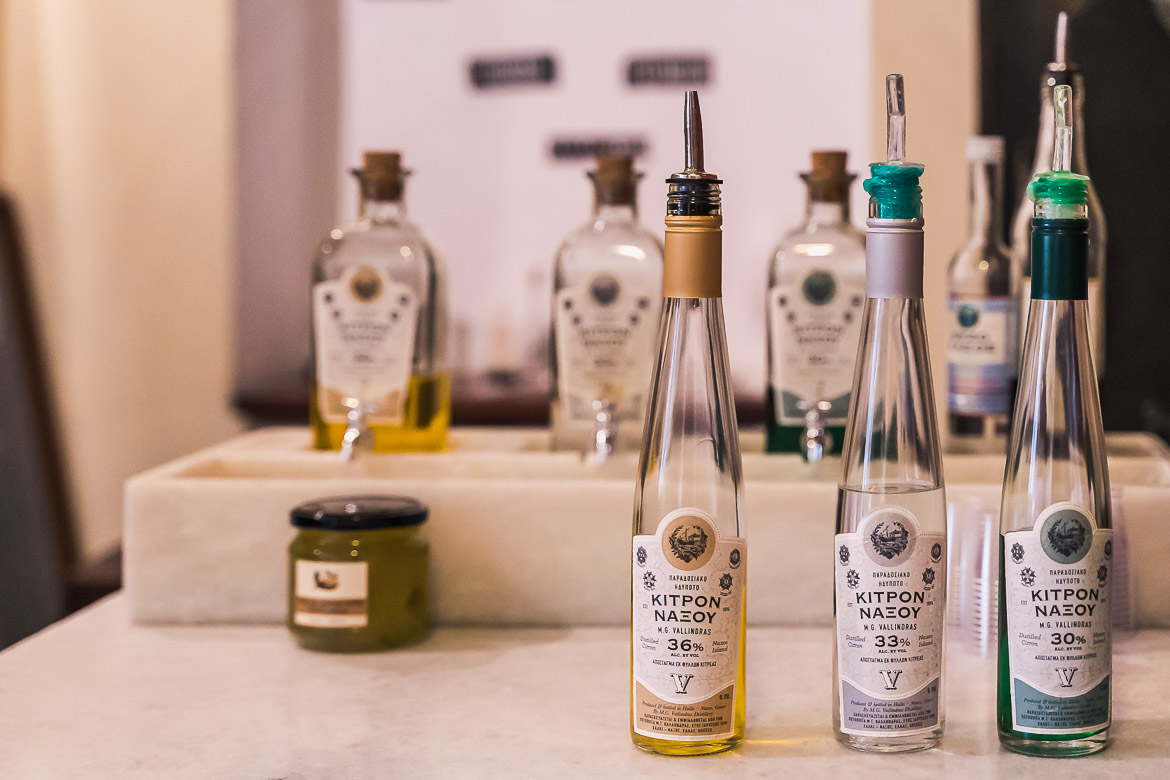 This image shows three bottles of citrus liqueur at Vallindras distillery in Chalki.
