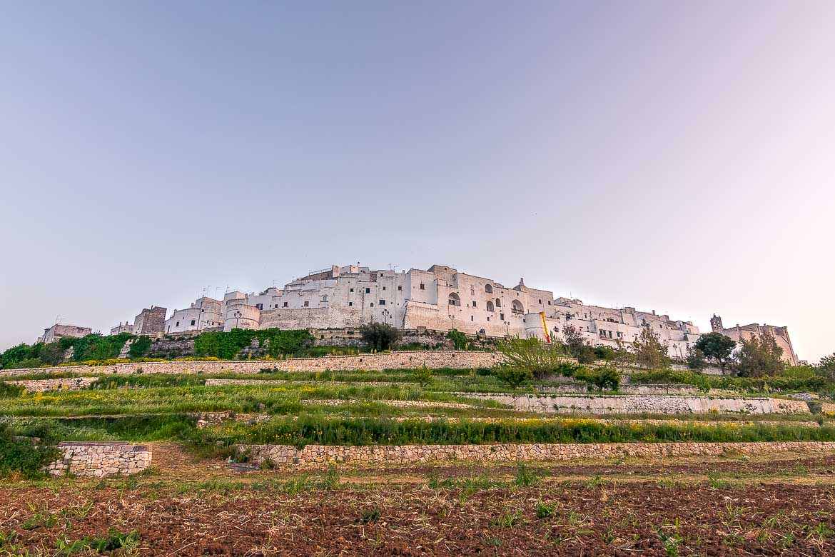 This is a panoramic photo of Ostuni Old Town built atop a hill.