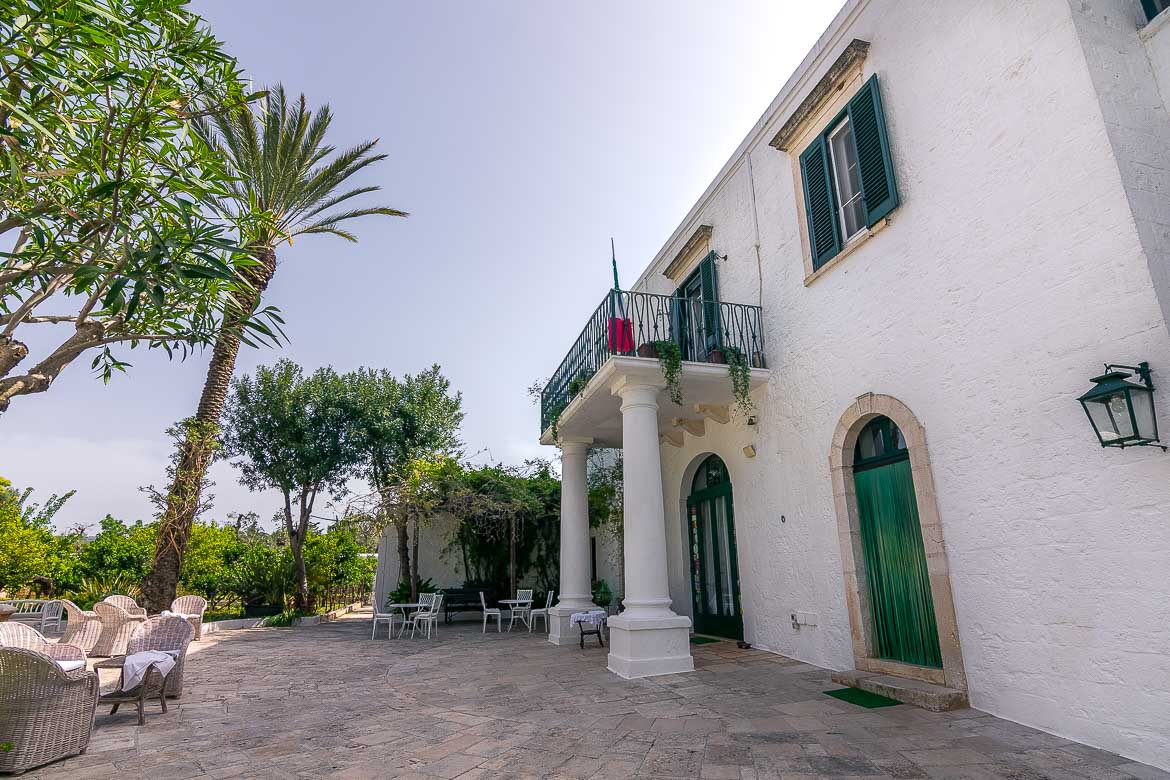 This is a photo of the central courtyard at Masseria Il Frantoio. The main building of the estate is on the right.