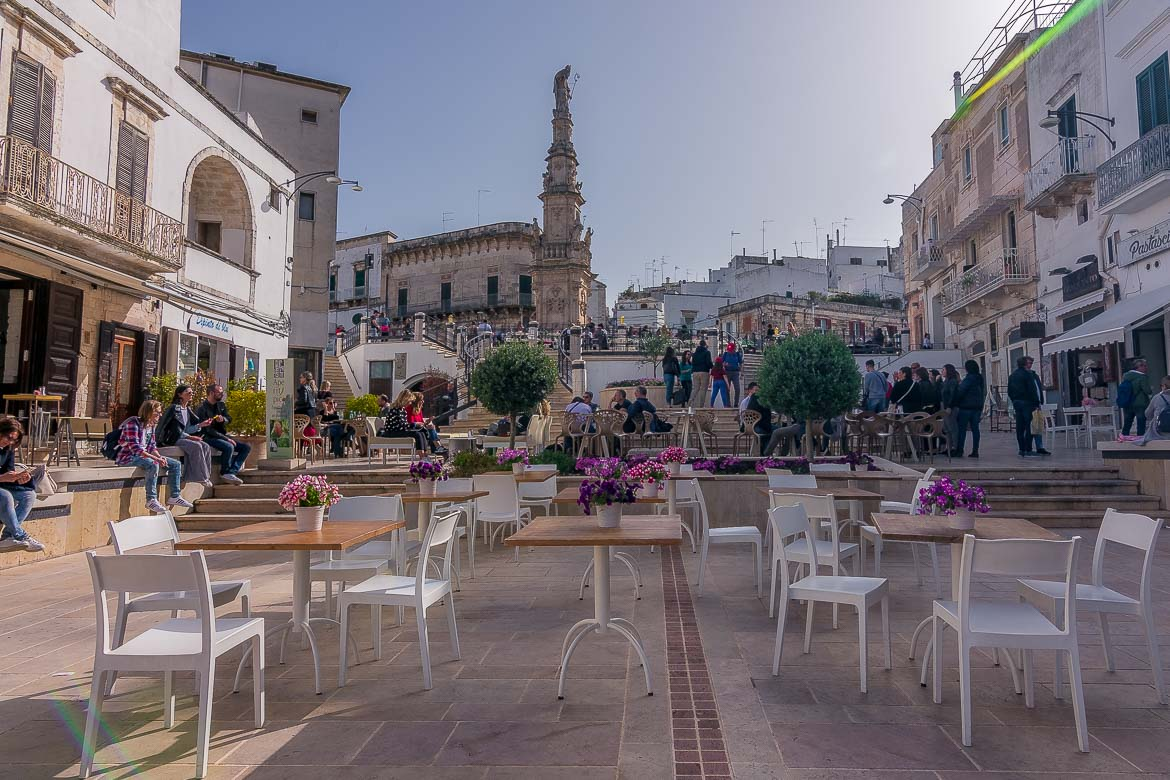 This is an image of the Piazza della Libeta. In the background, we can see the Sant'Oronzo column.