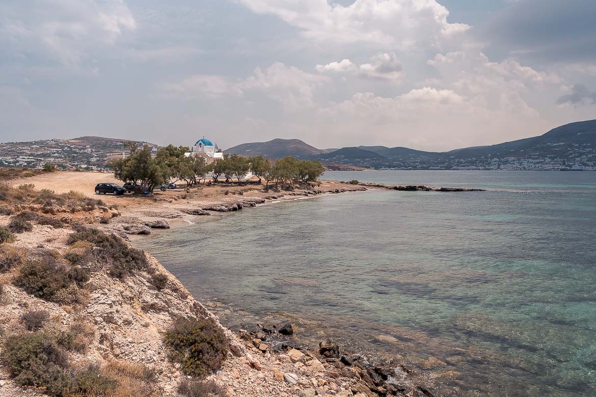 This is a panoramic shot of the area around Cape Agios Fokas. There is the small church of Agios Fokas above the beach.