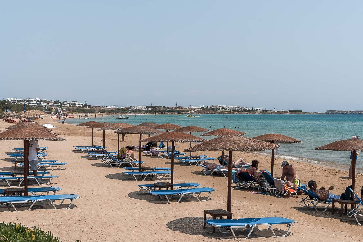 This is a photo of Golden Beach. There are sunbeds and umbrellas on the long stretch of golden sand.