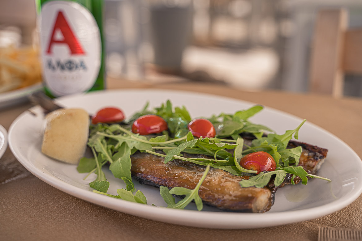 This is a close up of gouna fish topped with rocket and cherry tomatoes.
