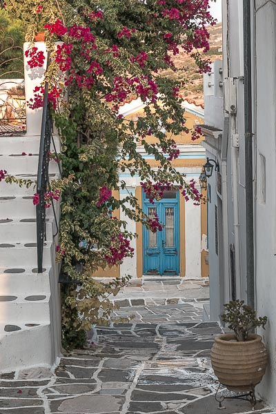 This photo was shot in Lefkes. It shows whitewashed steps, a bougainvillea and a gorgeous door. If you're wondering what to do in Paros Greece, a stroll around Lefkes should be very high on your list.