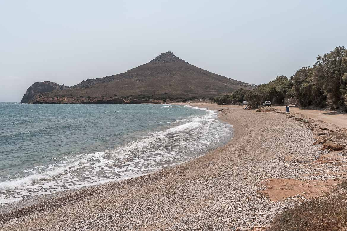 This is a panoramic shot of Molos Beach. It's a windy day. There are big waves and there's almost nobody on the beach.