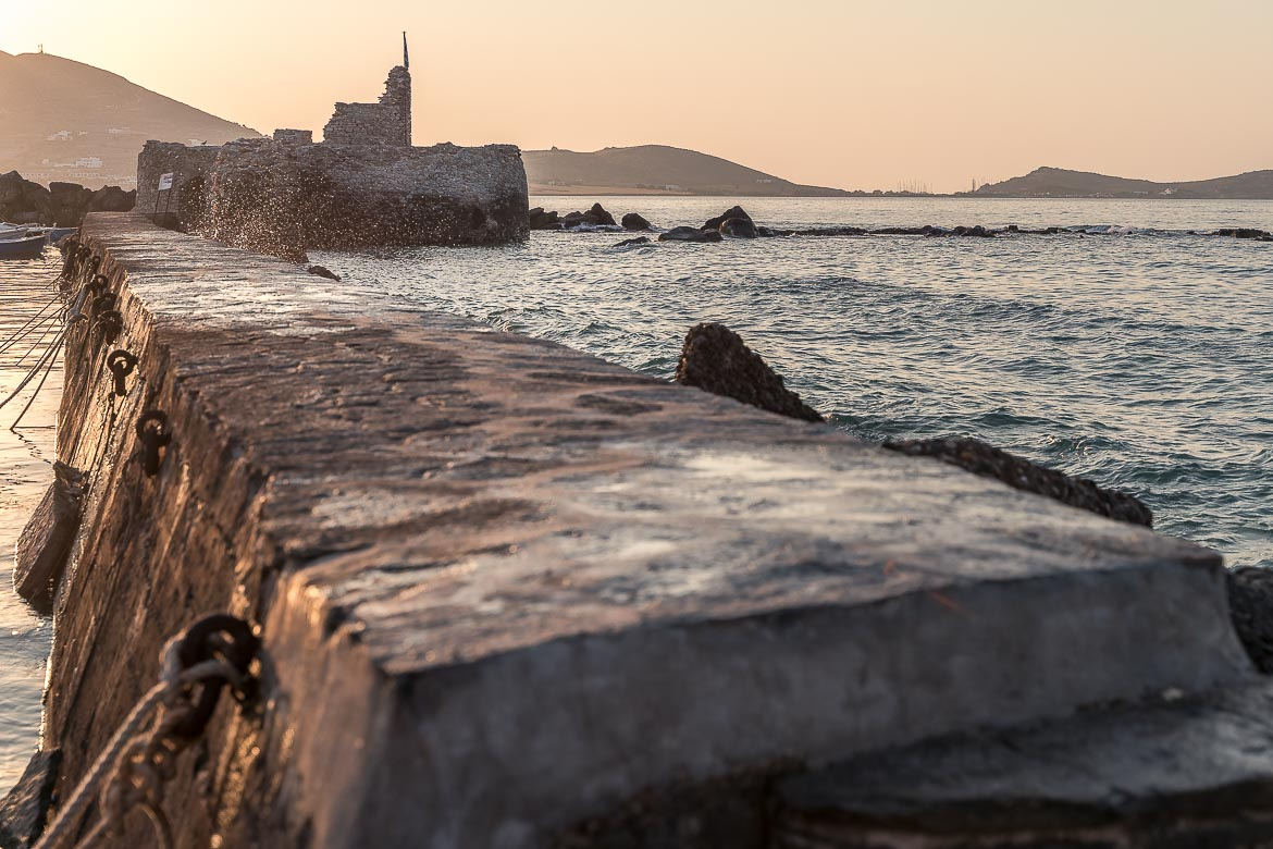 This is a close up of the pathway that leads to the Venetian Castle in Naoussa. The latter can be seen in the background. Visiting the castle of Naoussa at sunset is one of the best things to do in Paros Greece.