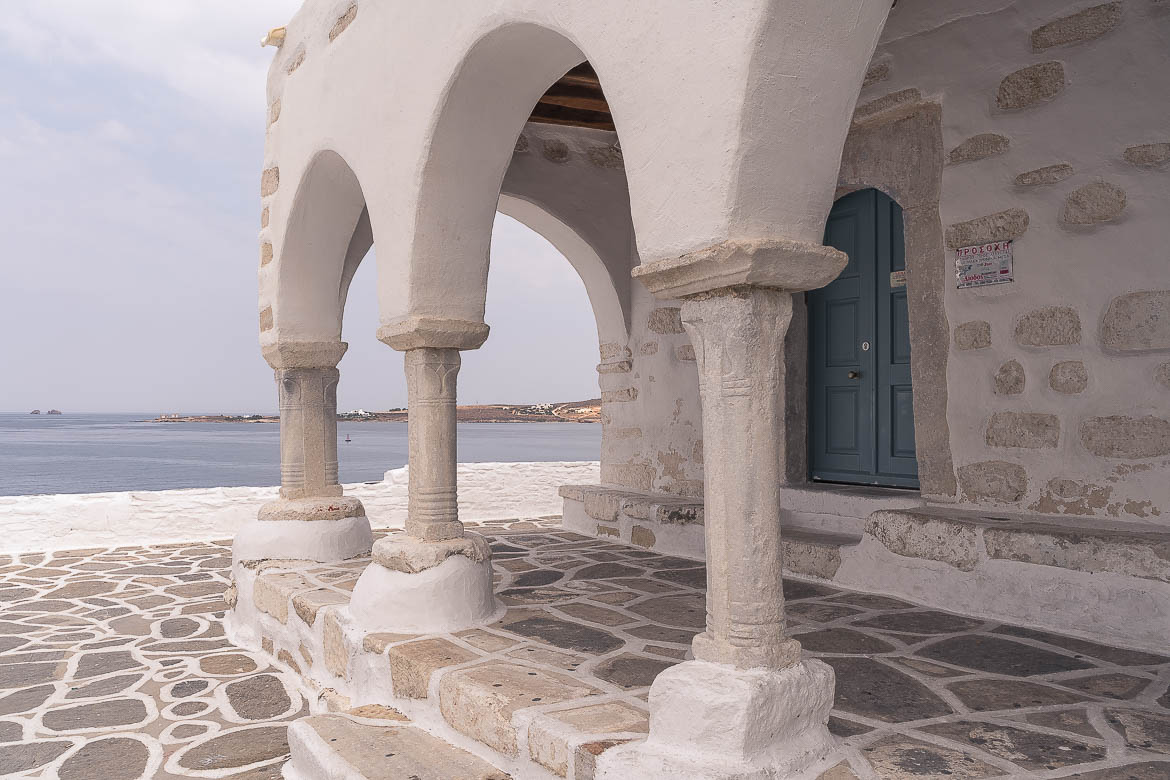 This photo is a close up of a gorgeous church that dominates the old castle of Parikia with its stunning views to the sea for as far as the eye can see.