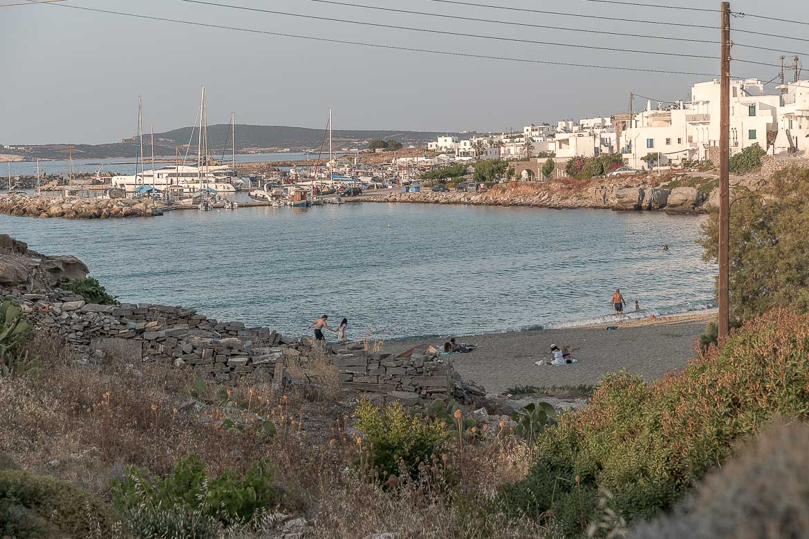 This is a panoramic shot of peaceful Piperi Beach with Naoussa in the background.