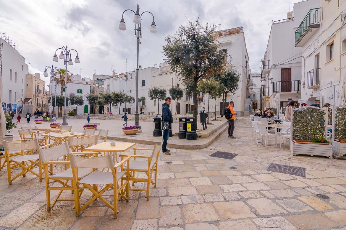 This photo shows a picturesque square in the Old Town. Wandering around the historic centre tops the list of what to do in Polignano a Mare.