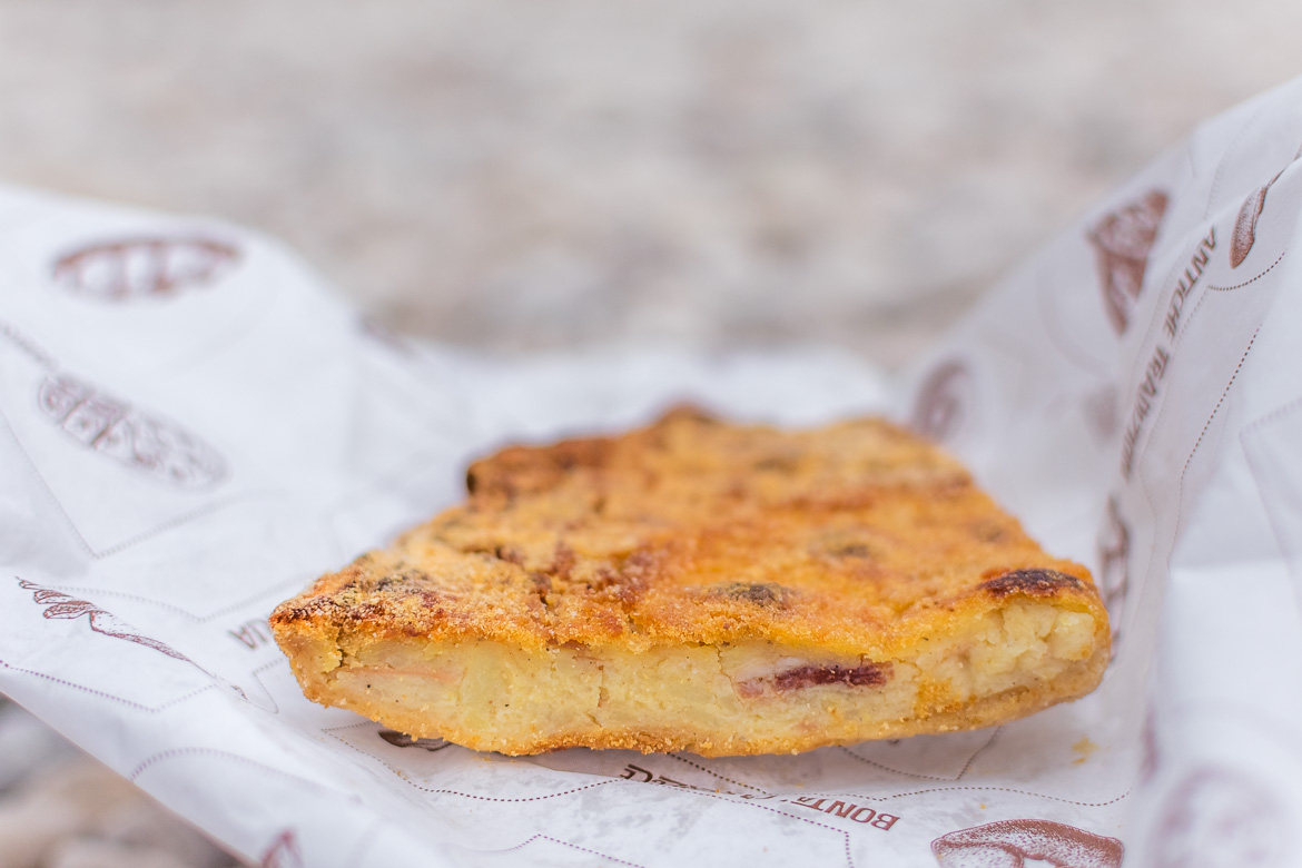This is a close up of focaccia ripiena. This means stuffed focaccia and it's one of hundreds of variations of this staple street food in Puglia.