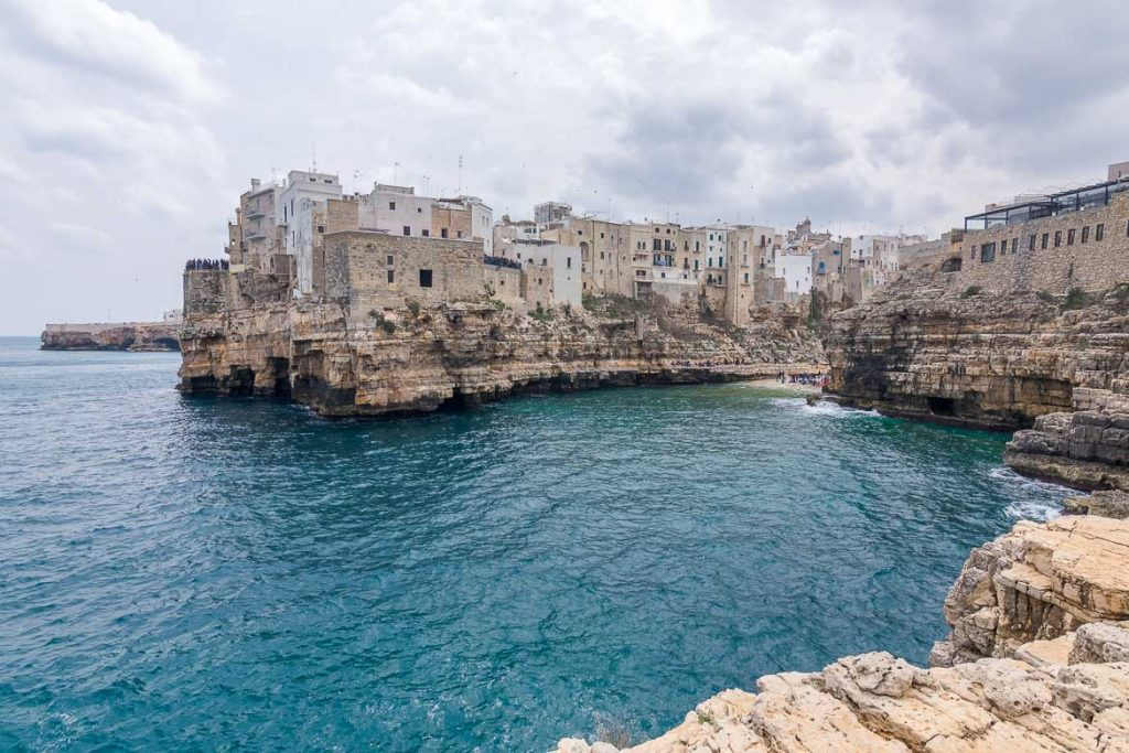 This is a panoramic view of Polignano a Mare from Petra Piatta. This is our favourite view of the town. This is why we chose this photo as the featured image of our article: What to do in Polignano a Mare Italy in one day.