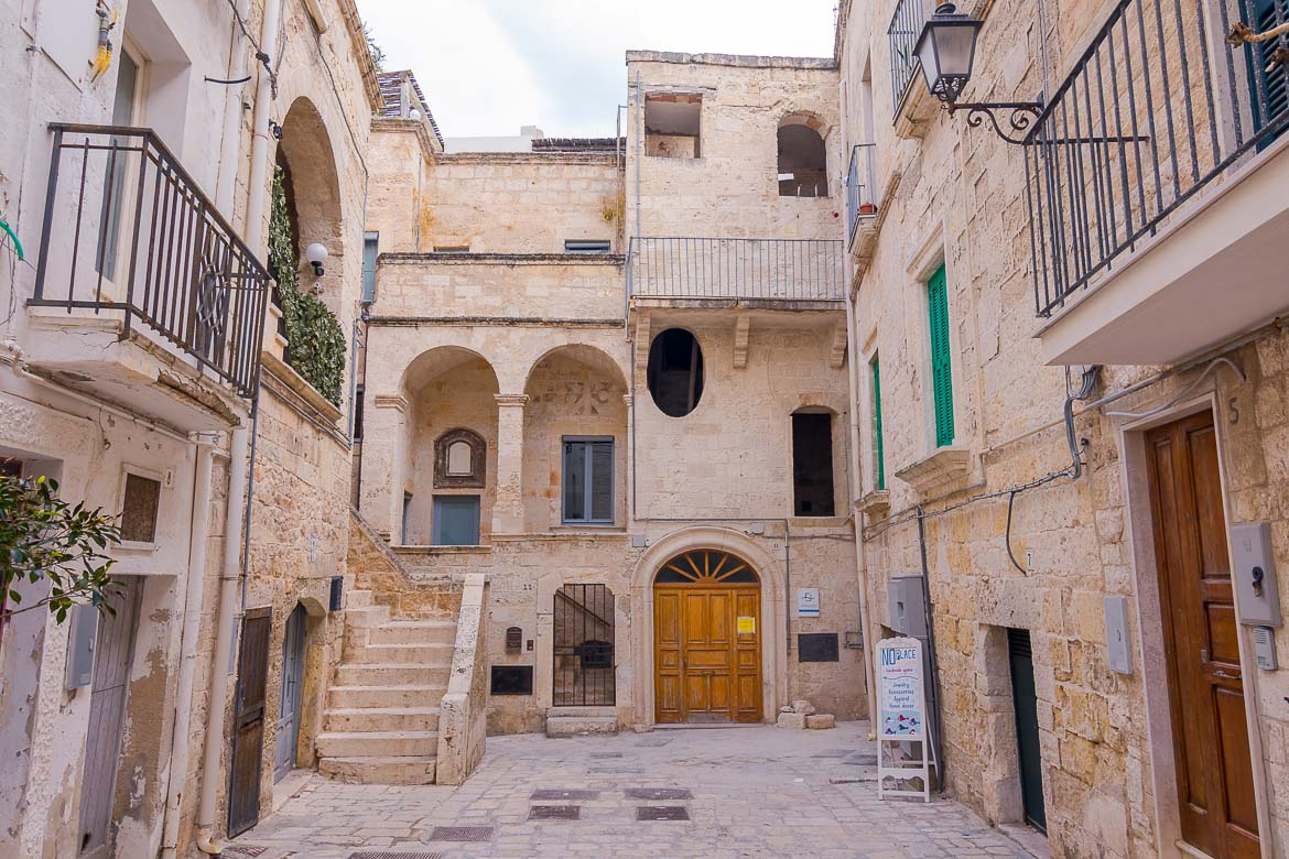 This is a photo of a courtyard in the Old Town. There are gorgous old buldings and there isn't anyone around.