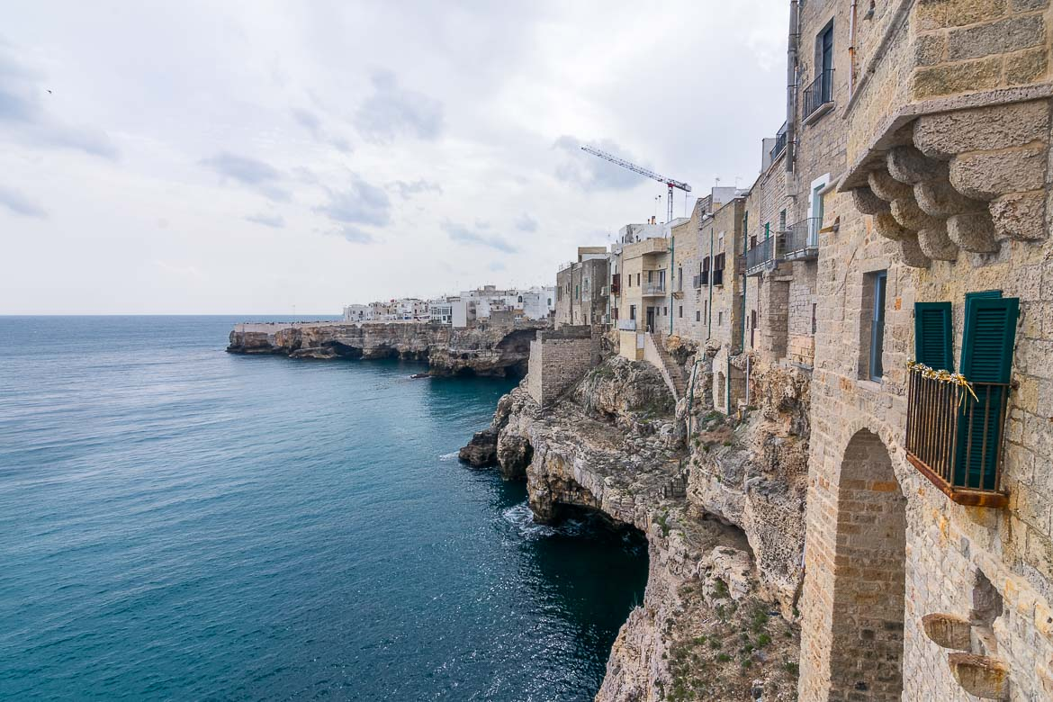 This is a photo of the old town hanging on the cliff above the sea. The bulidings are carved on the rock and they face the Adriatic Sea beyond. At the foot of the cliff there are numerous sea caves.