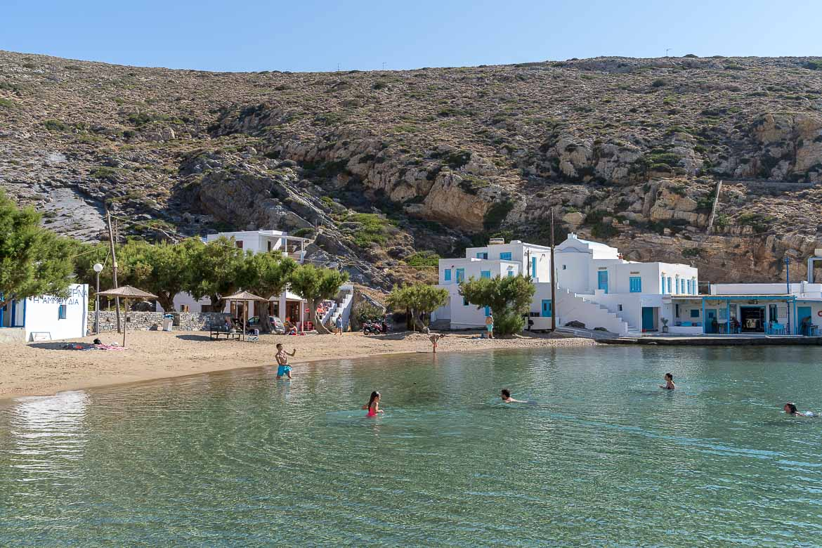 This is a panoramic shot of Cheronissos. We can see the beach with the emerald waters as well as a couple of buildings right on the beach.