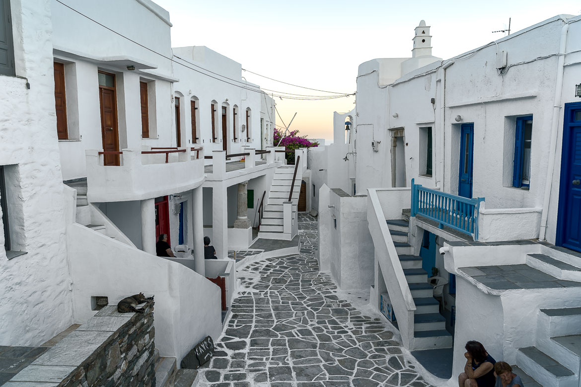 This is photo of one of the main streets in Kastro. It is lined with traditional whitewashed buildings on both sides.