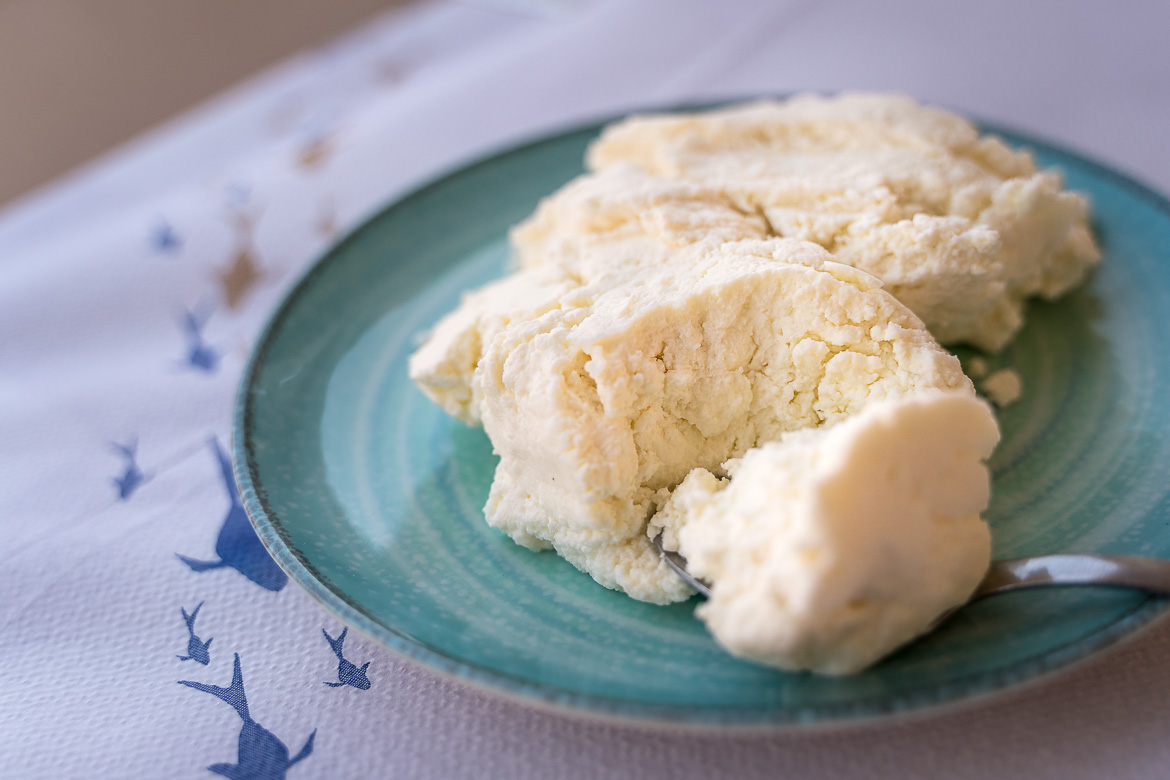 This is a close up of a dish containing soft local cheese.