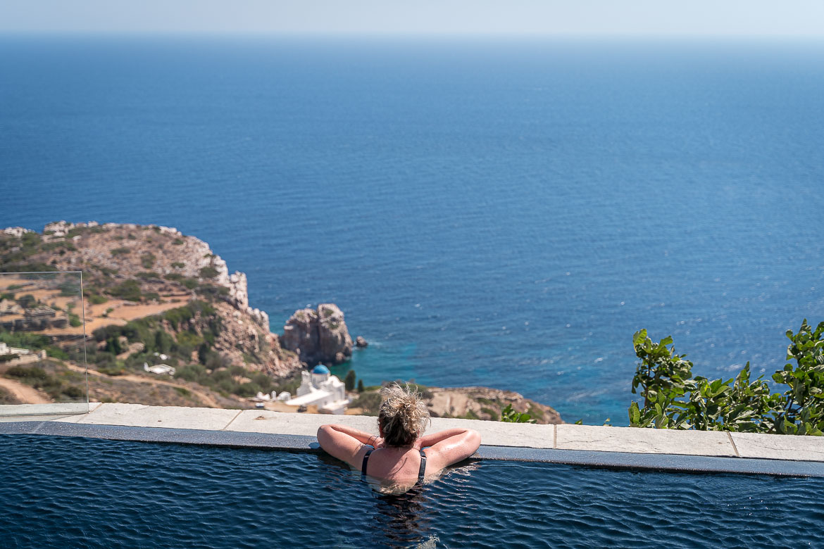 This is a photo of Maria. She is inside the pool admiring the view to the sea beyond.