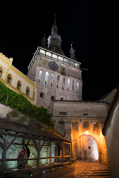 The romantically lit passageway below the Clock Tower in Sighisoara, Transylvania. What to do in Sighisoara Romania in 24 hours.