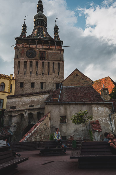 Next to the Clock Tower in Sighisoara Transylvania there is a resting area with numerous wooden benches and views to the Lower Town. What to do in Sighisoara Romania in 24 hours.