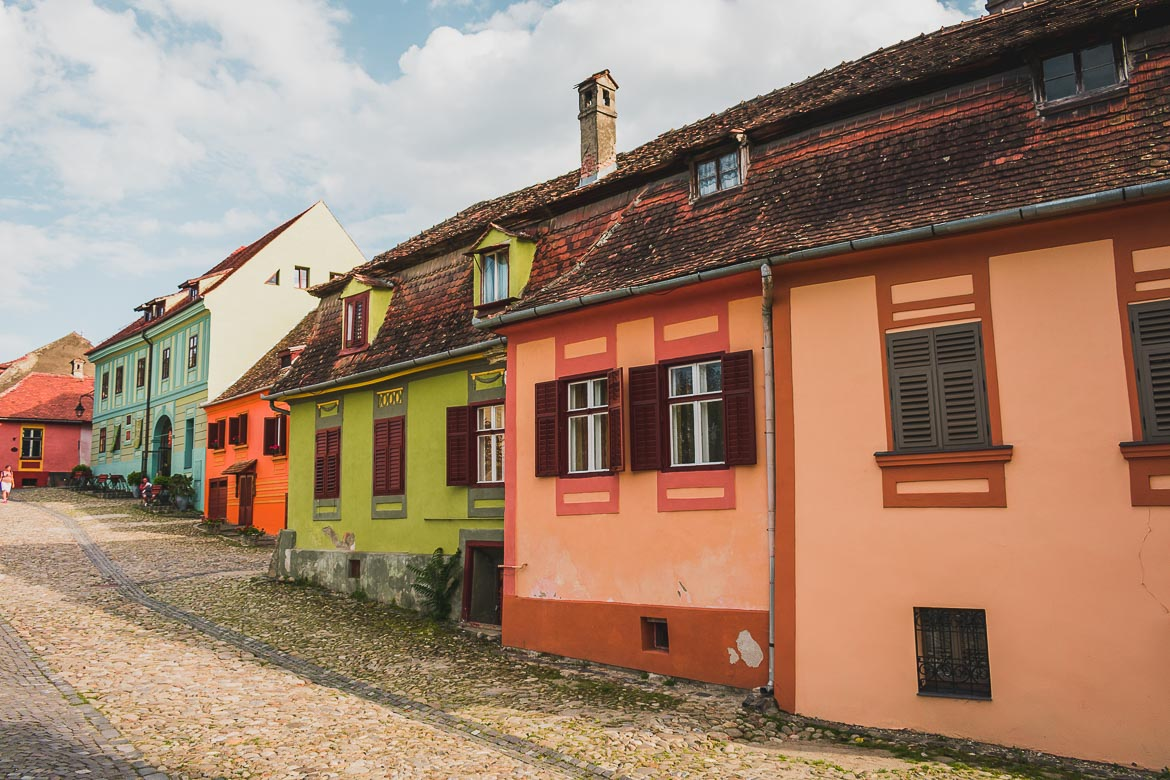 Sighisoara's cobbled streets are lined with colourful buildings. What to do in Sighisoara Romania in 24 hours.