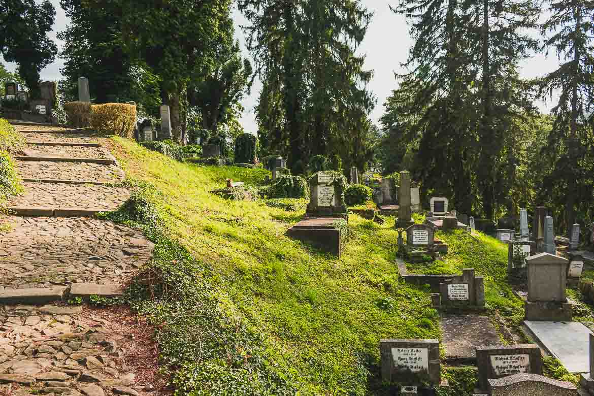 This photo shows the Saxon Cemetery located on School Hill in Sighisoara, Transylvania. What to do in Sighisoara Romania in 24 hours.