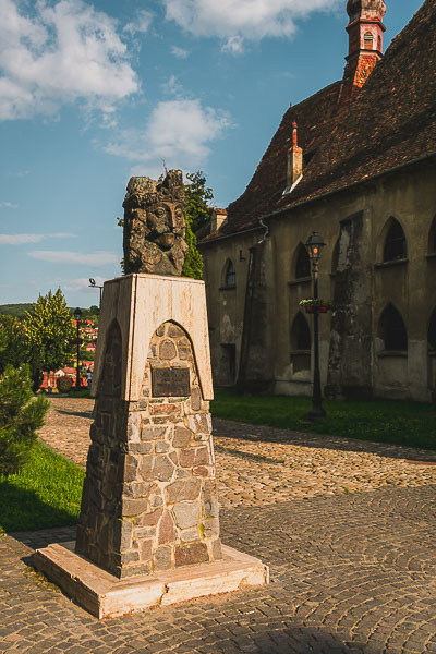 The statue of Vlad Tepes next to the Church of the Dominican Monastery in Sighisoara Transylvania. What to do in Sighisoara Romania in 24 hours.