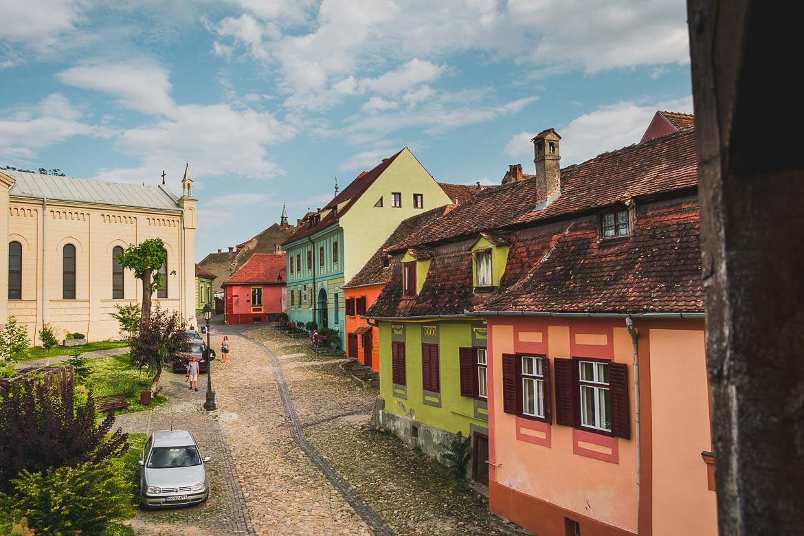 Cobblestone streets and colourful buildings in Sighisoara, Transylvania. What to do in Sighisoara Romania in 24 hours.