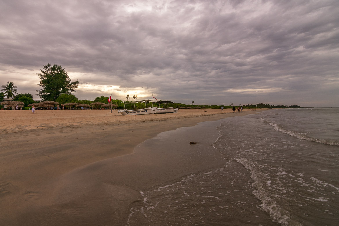 This photo shows Nilaveli beach on a cloudy afternoon. There are almost no people on the beach.