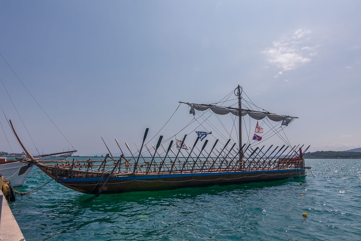This image shows the replica of Argo, a wooden ancient style boat that is tied near Volos Port.